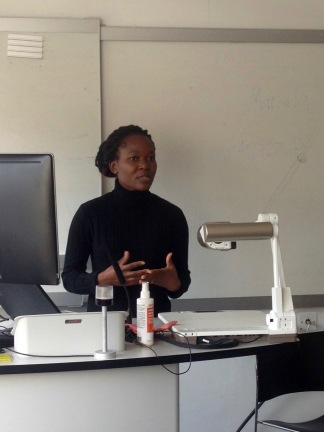 "Betty Wisiki presenting her work, ""An exploratory analysis of the experiences of Deaf students in accessing higher education in UK universities"""